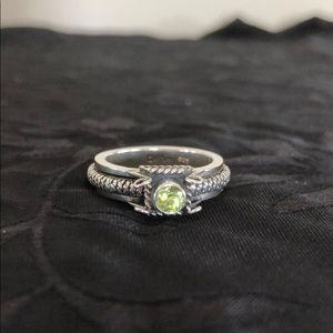 Sterling silver ring with light green stone.